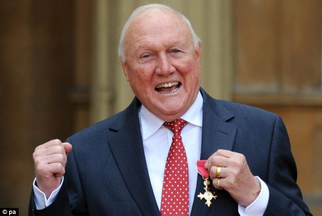 Honour: Hall pictured receiving the OBE from the Queen, for his services to broadcasting and charity last year