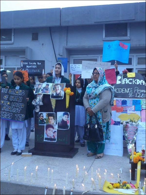 Here, and in several other photos, Peshawar residents seem genuinely convinced Pozner was a victim of their recent massacre, as his photo hangs directly beneath the microphone of a speaker's podium surrounded by mourners. / Image credit: APSACS Facebook