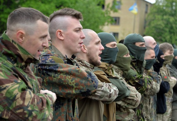 Volunteers of Ukrainian Azov regiment attend a ceremony before their departure to the east of Ukraine after taking part in trainings at their base in Kiev on May 7, 2015.Ukrainian and separatist representatives met in Minsk on May 6, 2015 for the first time since the two sides inked a shaky peace deal in February that dampened much of the fighting but failed to halt clashes at key hotspots. AFP PHOTO/GENYA SAVILOV